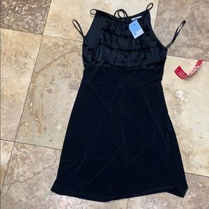 Silky black dress with ruffles
